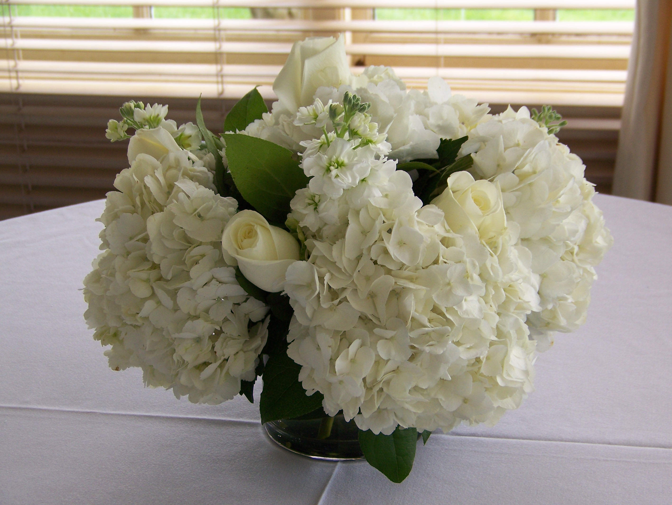 Centerpiece Of White Roses Stock And Hydrangea